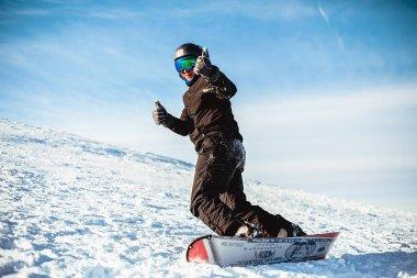 Happy man riding snowboard in winter stock vector