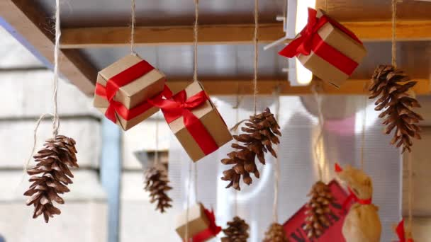Hanging presents and pine cones