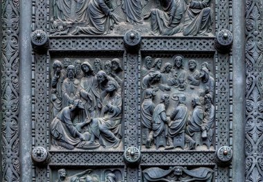 Fragment of Bremen's Cathedral Metalic Door with decorations depicting Jesus washing the feet of the disciples and Last supper, Germany. Reliefs were designed by Peter Fuchs in 1891. stock vector