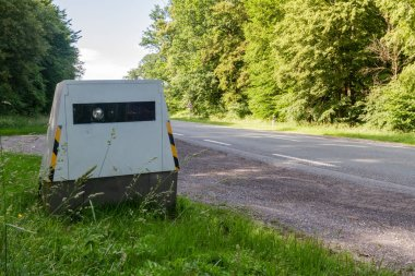 Automatic speed camera flashing cars driving too fast