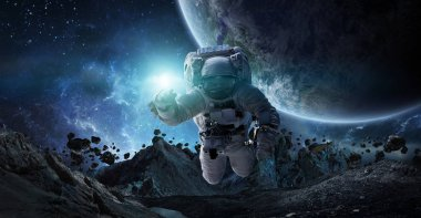 Astronaut floating in space in front of planets 3D rendering elements of this image furnished by NASA