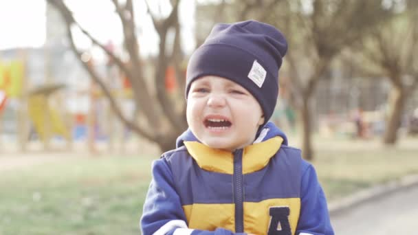 Charming little boy crying in the street. Slow Motion Video
