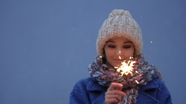 Winter young woman portrait with burning firelight .