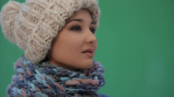 Happy winter woman in warm clothes outdoors. Snow falling in super slow motion 180fps HD footage.