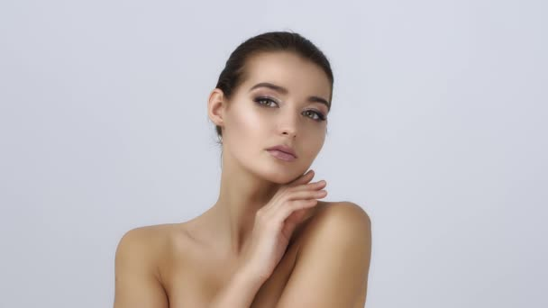 Portrait of beautiful and sexy woman on white. Skin care and cosmetics concept