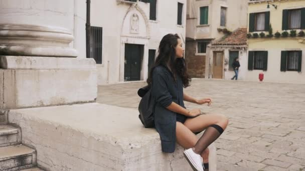 Attractive girl on square streets of Venice