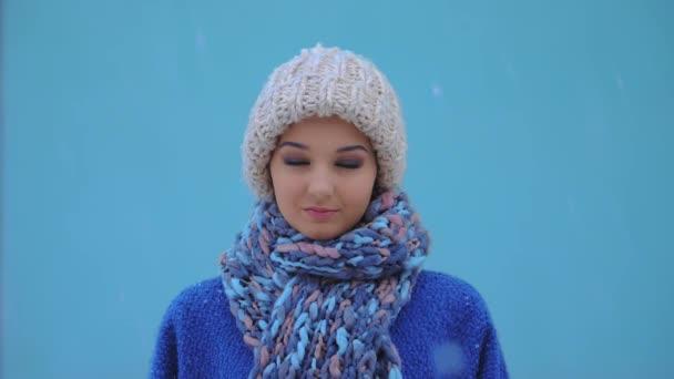 Winter woman portrait outdoors. Snow falling in super slow motion 180fps HD footage.