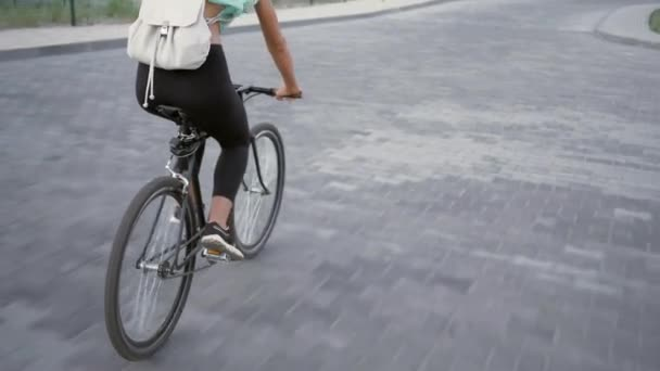 Young woman riding a bicycle outdoor