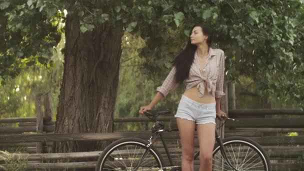 Young woman with a bicycle outdoor