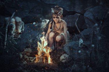 Şamanlar çocuğa ateş