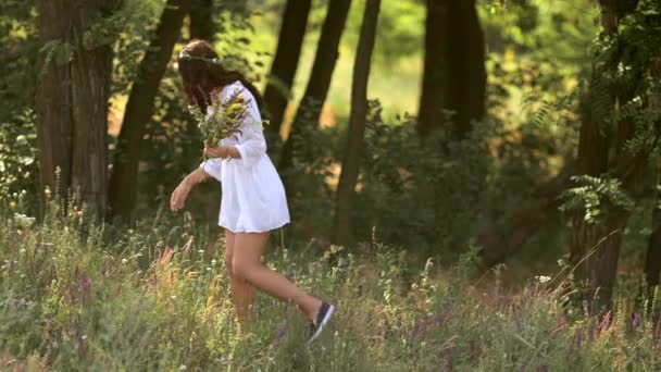 Natural beauty girl gathering flowers outdoor in freedom enjoyment concept.