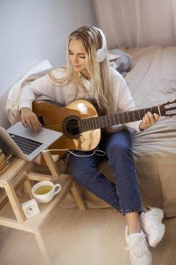 Girl Playing Guitar at Home