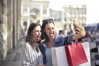 Two girl take selfie in the city