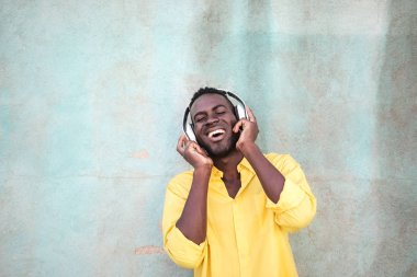 young black man listening to the music happily