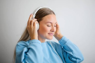 Blonde girl is listening the music