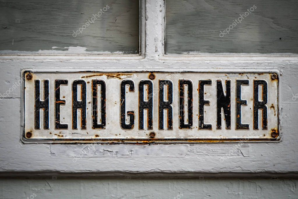 A Head Gardener's Sign On A Rustic Wooden Greenhouse Door At A Stately Home