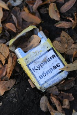 abandoned pack of cigarettes with the words