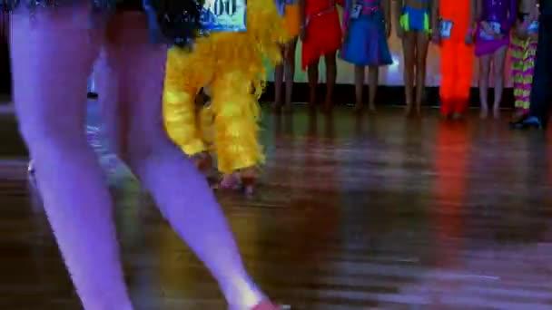Legs of dancers on the dance floor
