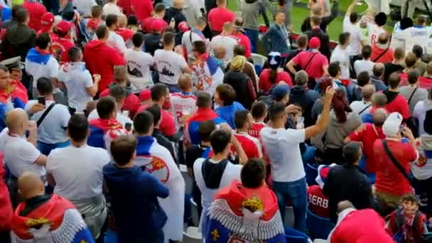 Kaliningrad - Russia, June 22, 2018: Football fans support teams on the match between Serbia and Switzerland