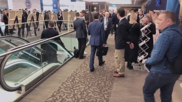 Visitors of business conference converse at the hall