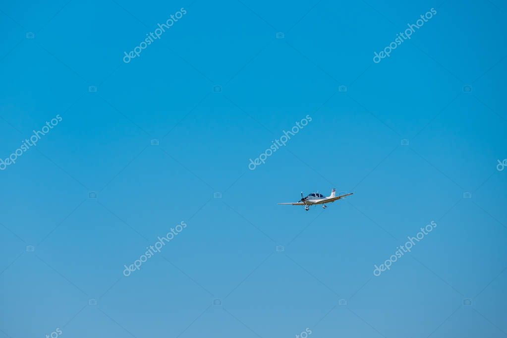 Small private jet airplane preparing for landing at day time in international airport
