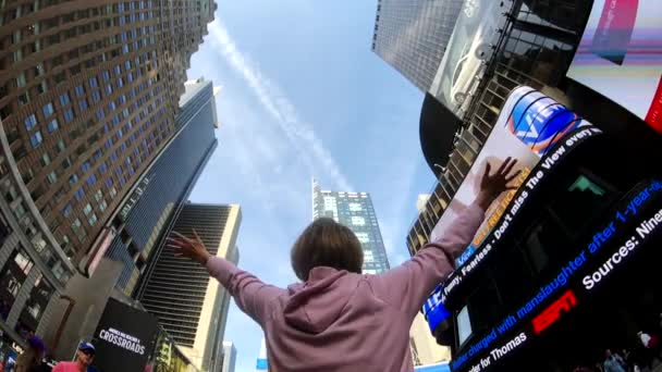 Young woman is happy from being in Times Square