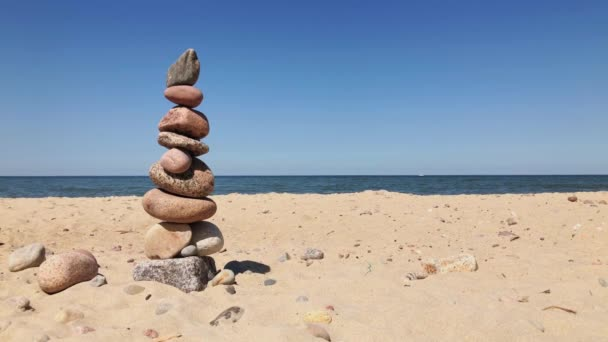 Pebbles in a pyramid on the seashore