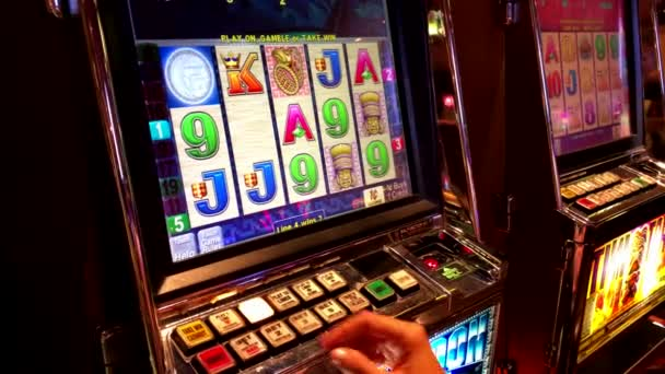 People are playing slot machines at MGM casino