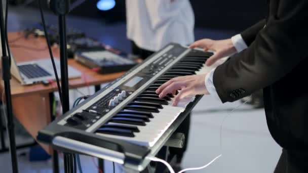 Musician tunes electronic musical instrument