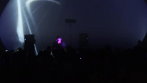 Crowd dancing near DJ in nightclub