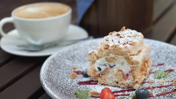 Delicious dessert on plate in outdoors cafe