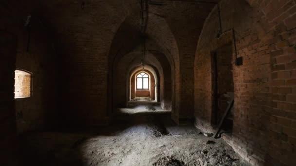 Walk through corridor of aged brick building