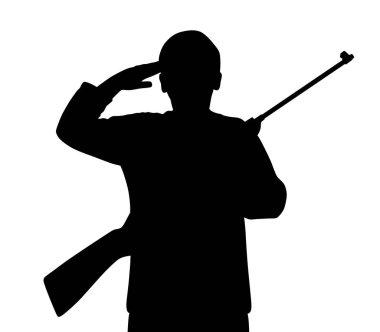 Young man saluting with gun