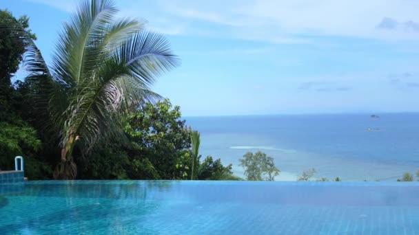 Infinity edge of swimming pool with beautiful sea view. slow motion.