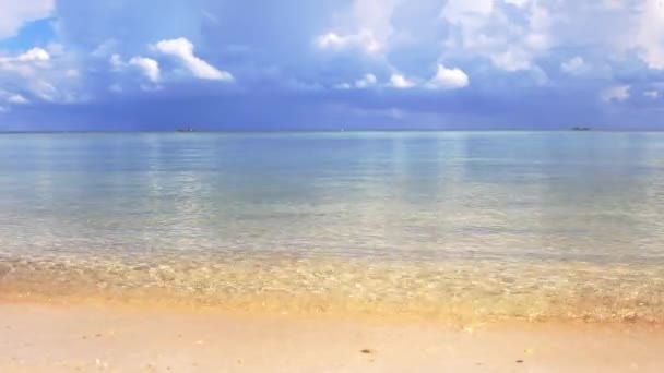 Ocean waves and cloudy sky background. Amazing tropical beach. White sand and crystal-blue sea video with sound. 3840x2160