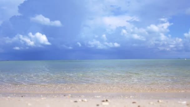 Paradise landscape of amazing tropical beach. Ocean waves and cloudy sky background. White sand and crystal-blue sea. slwo motion. 3840x2160