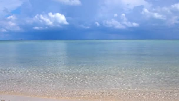 Amazing tropical beach. Ocean waves and cloudy sky background. White sand and crystal-blue sea. slow motion. 3840x2160