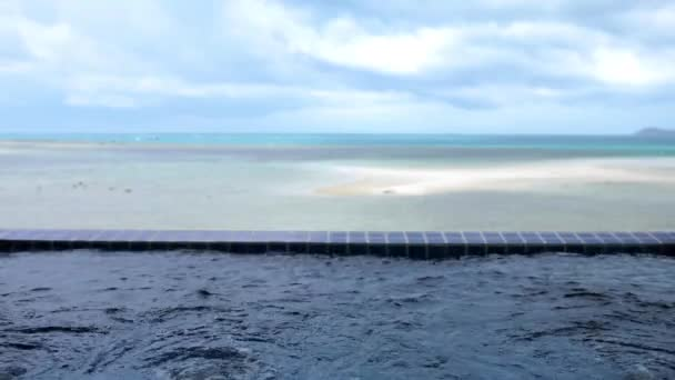 Travel vacation luxury spa jacuzzi pool from Koh Samui Resort Hotel on the sea background. Thailand. slow motion. 3840x2160, 4k