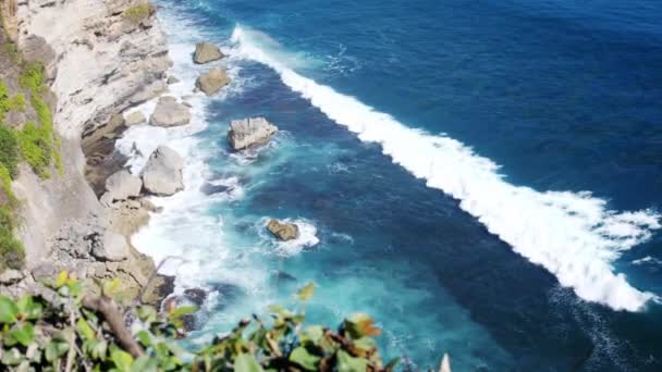 Amazing landscape of stone cliffs, ocean waves and oceanscape. Aerial top view. Bali, Indonesia. slow motion. 3840x2160