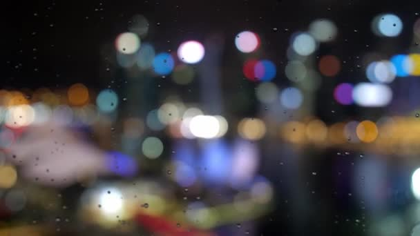 Abstract blurred light with office building and reflection night view on Singapore with rainy drops on the window, 3840x2160, 4k