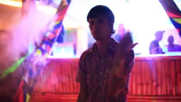 Young hipster handsome man dancing hip hop style, listening to music in a night club, neon lights, disco party club, having fun. 1920x1080