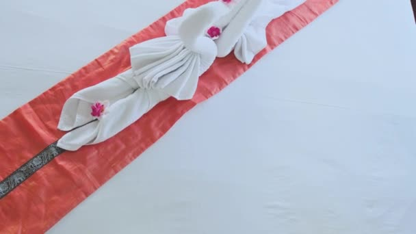 Top of view of beautiful swans made from white towels in Koh Phangan island hotel. slow motion. 3840x2160