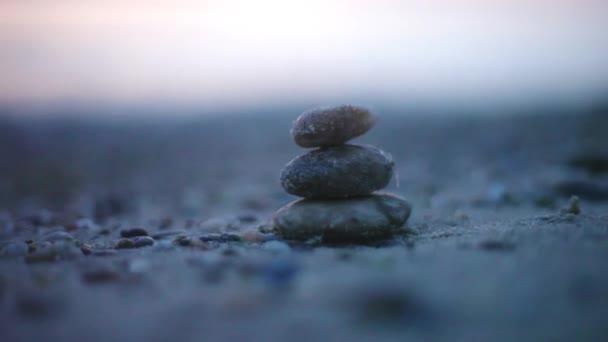Stones balance on the beach at sunset. Concept of peace and harmony. 1920x1080