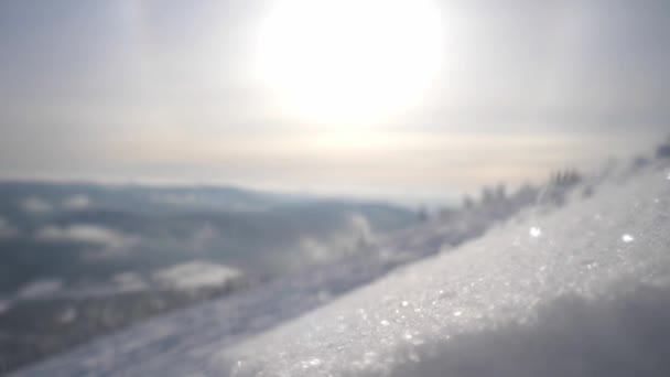 Beautiful winter landscape with sunny snow, snowflakes in mountains. slow motion. lens flare effects. 3840x2160