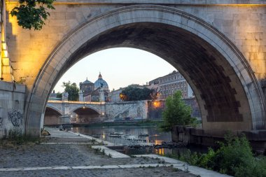 ROME, ITALY - JUNE 22, 2017: Sunset view of Tiber River, St. Angelo Bridge and St. Peter's Basilica in Rome, Italy