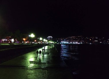 Night Embankment.Walk on the night quay