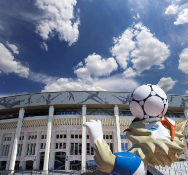 MOSCOW, RUSSIA  AUGUST 10, 2018: Official mascot of the 2018 FIFA World Cup in Russia-- wolf Zabivaka and Luzhniki Olympic Complex -- Stadium for the 2018 FIFA World Cup. Moscow