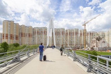 MOSCOW, RUSSIA  MAY 29 2017:  Pavshinsky Bridge (also bridge Pavshinskaya Poima or Spassky Bridge) is pedestrian cable-stayed bridge across Moskva River. Krasnogorsk, Moscow region, Russia