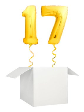 Golden number seventeen balloon flying out of blank white box isolated on white background