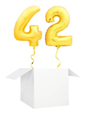 Golden number forty two inflatable balloon with golden ribbon flying out of blank white box isolated on white background